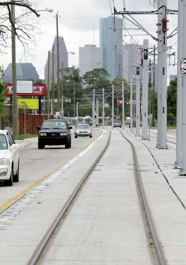 A real estate appraiser says expansion of the light rail line will create a new dynamic for mass transit in Houston and will spur more development along all sections of the line. Photo: Melissa Phillip, Staff / © 2013  Houston Chronicle
