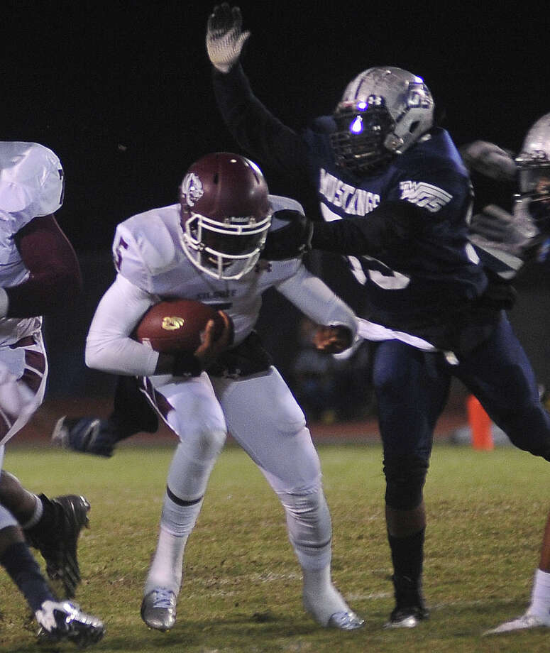 Silsbee quarterback Patrick Reed (No. 5) tries to avoid being tackled by a  West Orange-Stark defensive player during last week's game. Photo by Cassie Smith/@smithcassie.
