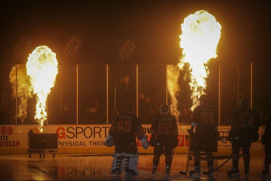 Fire balls shoot up from the ice during the opening ceremony for the San Francisco Bulls opening night match against the Bakersfield Condors at Cow Palace in San Francisco on November 8th 2013. Photo: Sam Wolson, Special To The Chronicle