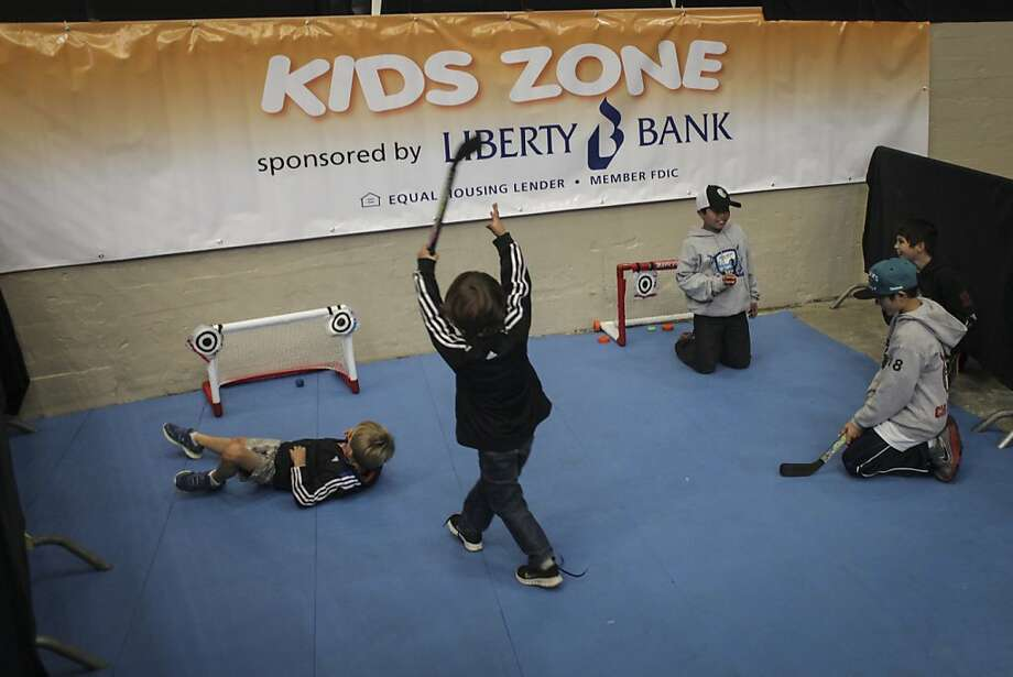 Kids play in the Kid Zone during the San Francisco Bulls opening night match against the Bakersfield Condors at Cow Palace in San Francisco on November 8th 2013. Photo: Sam Wolson, Special To The Chronicle