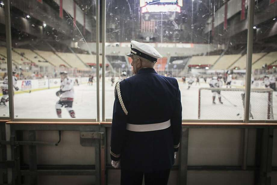 Chester Bartalini, a U.S Coast Guard Auxiliary, watches players warm up during the San Francisco Bulls opening night match against the Bakersfield Condors at Cow Palace in San Francisco on November 8th 2013. Photo: Sam Wolson, Special To The Chronicle