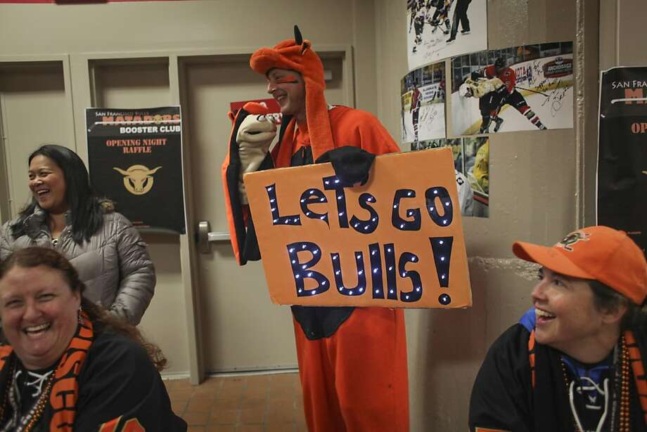 Jay Bergers III, a big Bulls fan, holds a light up Bulls sign and a puppet during the San Francisco Bulls opening night match against the Bakersfield Condors at Cow Palace in San Francisco on November 8th 2013. Photo: Sam Wolson, Special To The Chronicle