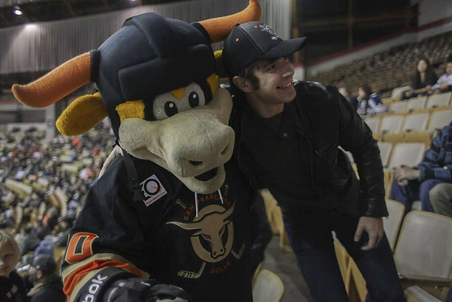 Rawhide, the Bulls official mascot, takes a photo with a fan during the San Francisco Bulls opening night match against the Bakersfield Condors at Cow Palace in San Francisco on November 8th 2013. Photo: Sam Wolson, Special To The Chronicle