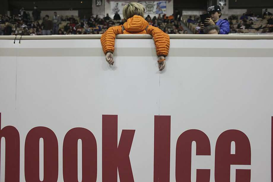 A fan rests his arms over a railing during the San Francisco Bulls opening night match against the Bakersfield Condors at Cow Palace in San Francisco on November 8th 2013. Photo: Sam Wolson, Special To The Chronicle