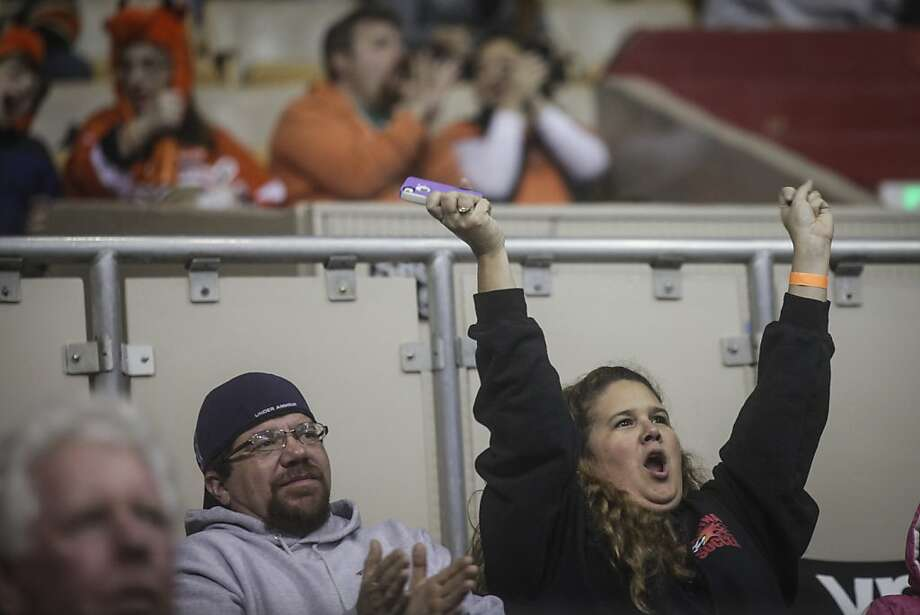 Fans celebrate during the San Francisco Bulls opening night match against the Bakersfield Condors at Cow Palace in San Francisco on November 8th 2013. Photo: Sam Wolson, Special To The Chronicle