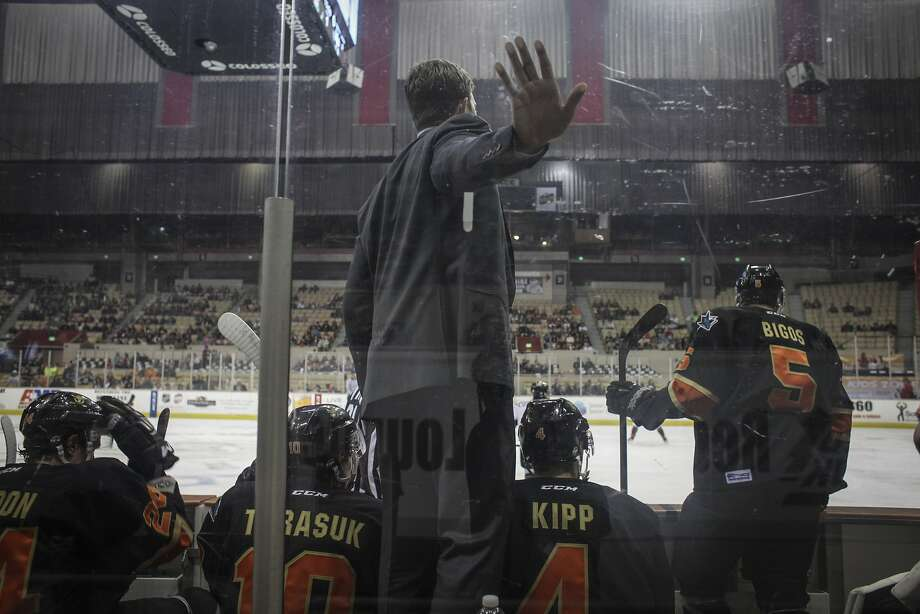 The San Francisco Bulls coach rests his hand on the glass during the San Francisco Bulls opening night match against the Bakersfield Condors at Cow Palace in San Francisco on November 8th 2013. Photo: Sam Wolson, Special To The Chronicle