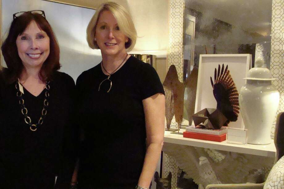 Bridget Schulten, left, and Barbara Johnson, two of the three founders of Rooms with a View, pose in the Southport Congregational Church library in front of the vignette created by Thom Filicia with Sedgewick & Brattle, his first to-the-trade showroom in the New York Design Center. Filicia is the honorary chairman of this year's the 19th annual Rooms with a View designer showcase. Photo: Meg Barone / Fairfield Citizen contributed