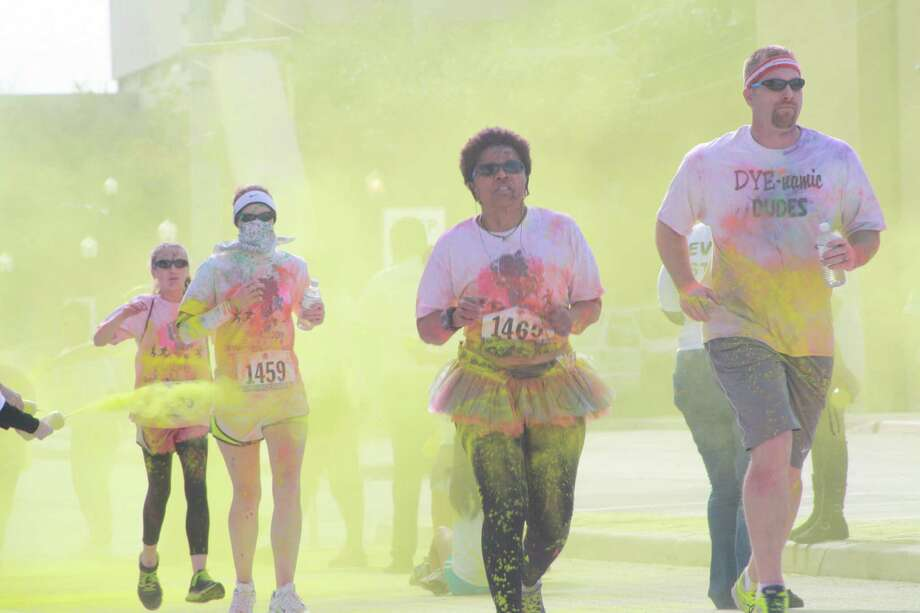 Runner  and walker enthusiasts woke early Saturday morning to join in the Compassion Color 5K. Photo: Jose D. Enriquez III