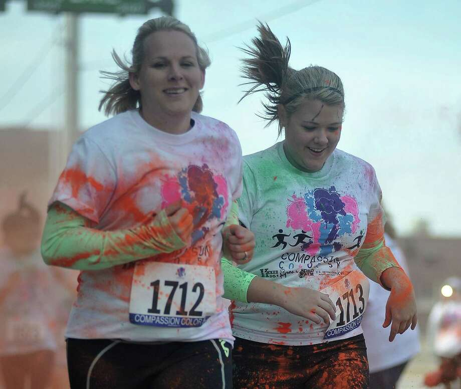 Benefiting indigent health care in Southeast Texas, residents joined together Saturday morning for the Compassion Color 5K in downtown Beaumont. Photo by Cassie Smith/@smithcassie. Photo: Cassie Smith/@smithcassie