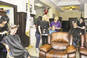 San Jacinto College cosmetology students visit De George at Union Station to provide veteran residents free haircuts as part of their service learning hours.