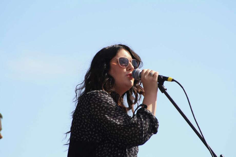 Special guest Kree Harrison performed in a mini-concert at the end of the Compassion Color 5K on Saturday. Bands Matthew Lewis and Flava opened for Harrison. Photo: Jose D. Enriquez III