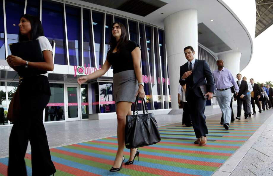 FILE -In this Wednesday, Oct. 23, 2013, file photo, job applicants arrives for an internship job fair held by the Miami Marlins, at Marlins Park in Miami. The government issues the October jobs report, on Friday, Nov. 8, 2013, which had been delayed a week because of the government shutdown. ( AP Photo/Lynne Sladky, File) ORG XMIT: NYBZ173 Photo: Lynne Sladky / AP