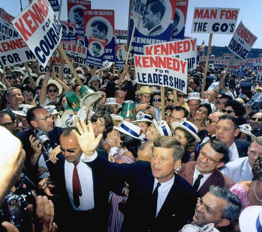 "Sen. John F. Kennedy made his way through a crowd of supporters and journalists in Los Angeles on July 9, 1960, at the Democratic National Convention. Kennedy's election in 1960 helped to bolster the spirits of many Americans from ""the greatest generation."" Photo: STF / AP"