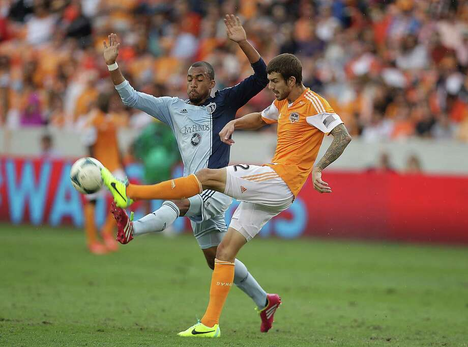 Sporting KC forward Teal Bunbury left, and Houston Dynamo defender Eric Brunner right, during the first half of the MLS Eastern Conference Final game at BBVA Compass Stadium Saturday, Nov. 9, 2013, in Houston. Photo: James Nielsen, Houston Chronicle / © 2013  Houston Chronicle