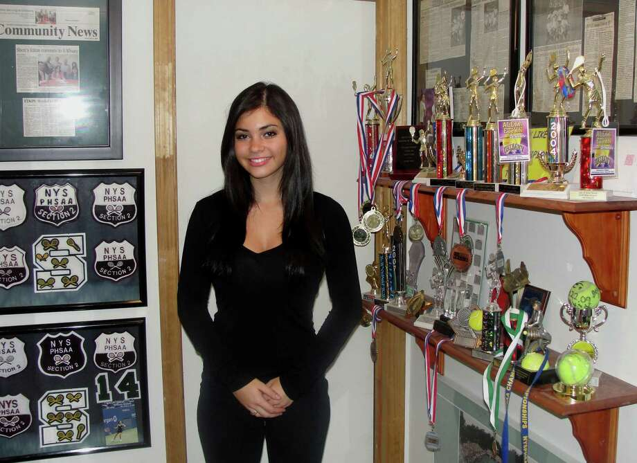 Fallon Victoria Etkin of Shenendehowa High School in the trophy room of her home.