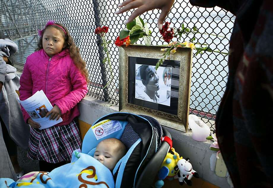 Azelea Price, 8, and 3-month-old Arius Biancco Price pay tribute to their uncle Biancco Price (pictured), who died on the Bay Bridge's old eastern span. Photo: Michael Macor, The Chronicle