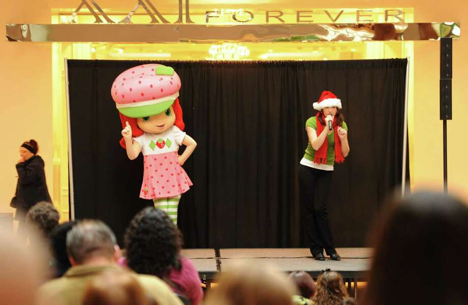 Children watch the interactive show featuring Strawberry Shortcake and Nikki Wadleigh singing to welcome Santa Claus at Danbury Fair in Danbury, Conn. on Saturday, Nov. 9, 2013.  Santa and Stawberry Shortcake stayed after the show for a meet-and-greet with photos. Photo: Tyler Sizemore / The News-Times