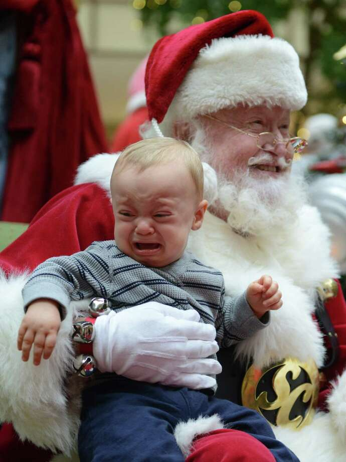 Declan Howard, 10 months, sits on Santa's lap after the interactive show featuring Strawberry Shortcake at Danbury Fair in Danbury, Conn. on Saturday, Nov. 9, 2013.  Santa and Stawberry Shortcake stayed after the show for a meet-and-greet with photos. Photo: Tyler Sizemore / The News-Times