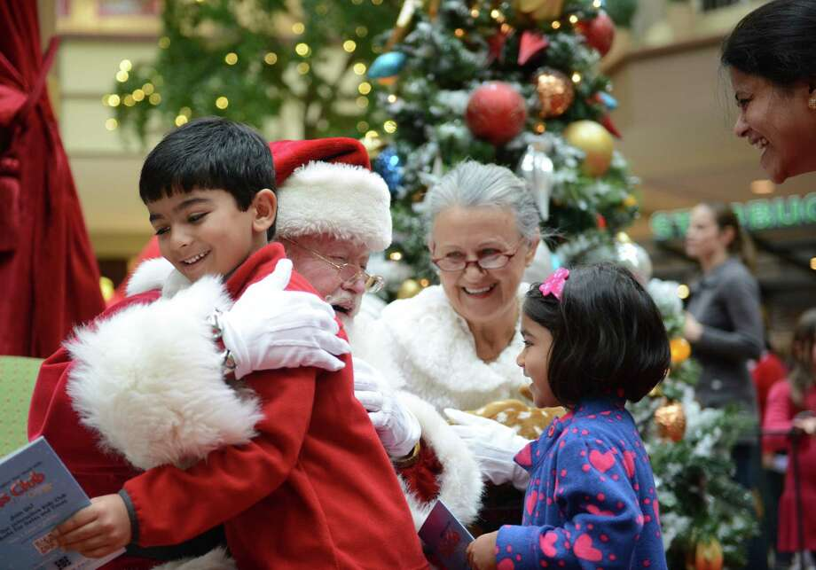 Children meet Santa and Mrs. Claus after the interactive show featuring Strawberry Shortcake at Danbury Fair in Danbury, Conn. on Saturday, Nov. 9, 2013.  Santa and Stawberry Shortcake stayed after the show for a meet-and-greet with photos. Photo: Tyler Sizemore / The News-Times