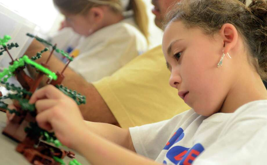 Amelia Melody, 8, of Fairfield, constructs trees out of Legos during a workshop at the Block Party at Fairfield Ludlowe High School Saturday, Nov. 9, 2013 to benefit the b-Cause Foundation and Make-A-Wish Connecticut. Photo: Autumn Driscoll / Connecticut Post