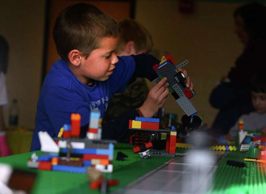 Billy Bardani, 6, of Easton, plays with a near limitless supply of Legos during the Block Party at Fairfield Ludlowe High School Saturday, Nov. 9, 2013 to benefit the b-Cause Foundation and Make-A-Wish Connecticut. Photo: Autumn Driscoll / Connecticut Post