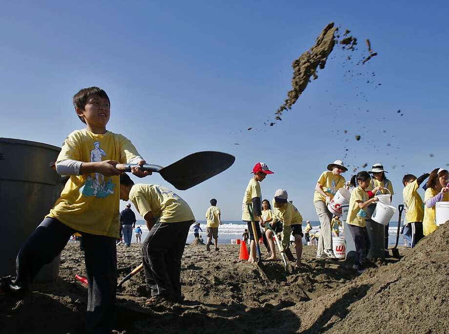 Nathan Chan of Robert Louis Steveson Elementary tosses a shovel full of sand in preparation for sculpting during the Leap Sand Castle Contest at Ocean Beach in San Francisco, Calif. on Saturday, Nov. 9, 2013. Photo: Raphael Kluzniok, The Chronicle