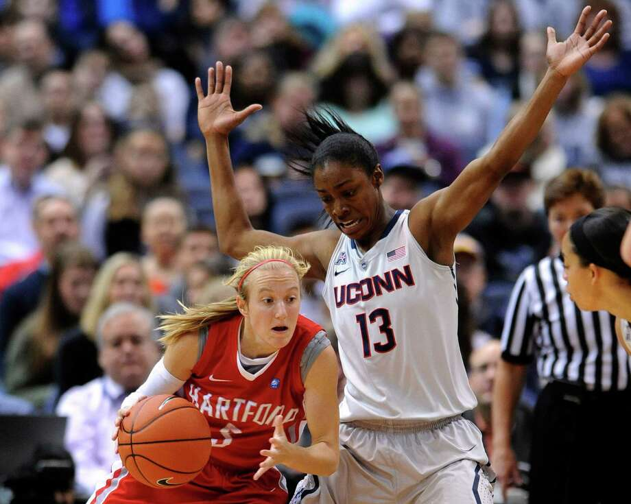 Connecticut guard Brianna Banks (13) guards Hartford guard Deanna Mayza (3) during the first half of an NCAA college basketball game in Hartford, Conn., on Saturday, Nov. 9, 2013. Photo: Fred Beckham, AP / Associated Press