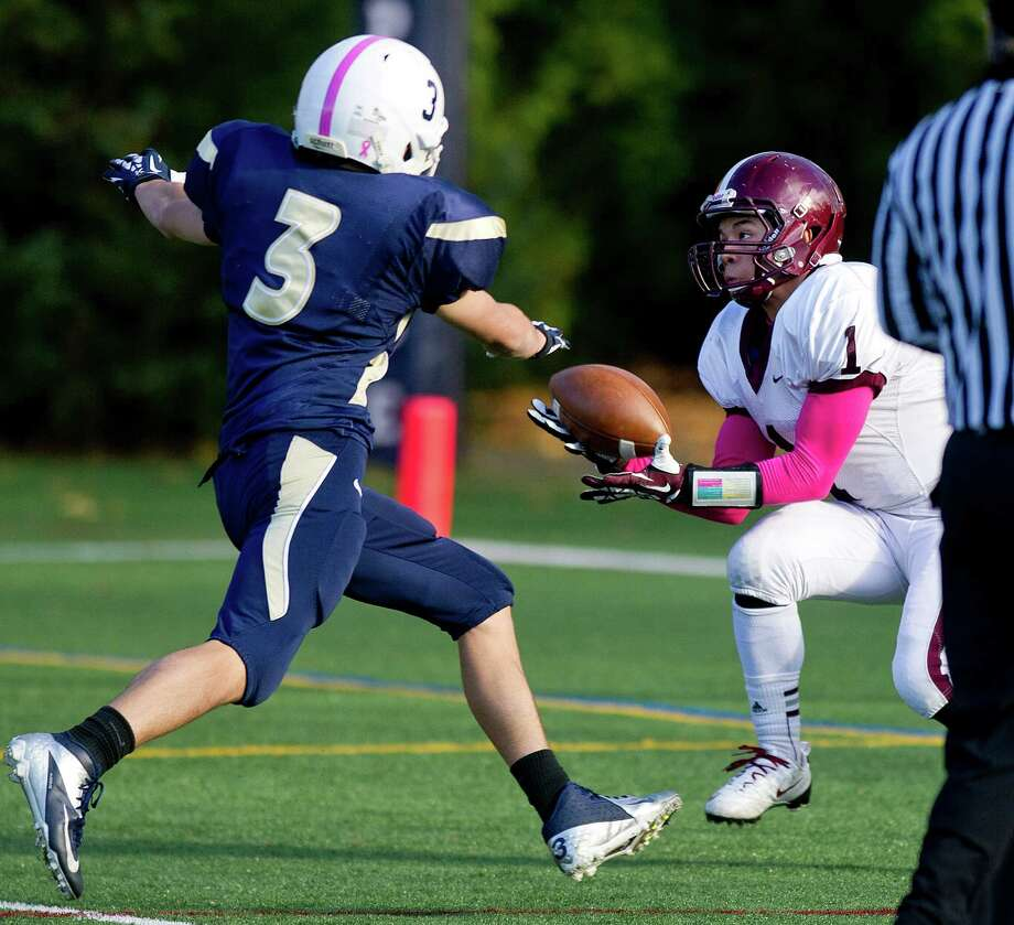 St. Luke's J.B. Boggs makes a catch for a touchdown during Saturday's football game at King on November 9, 2013. Photo: Lindsay Perry / Stamford Advocate