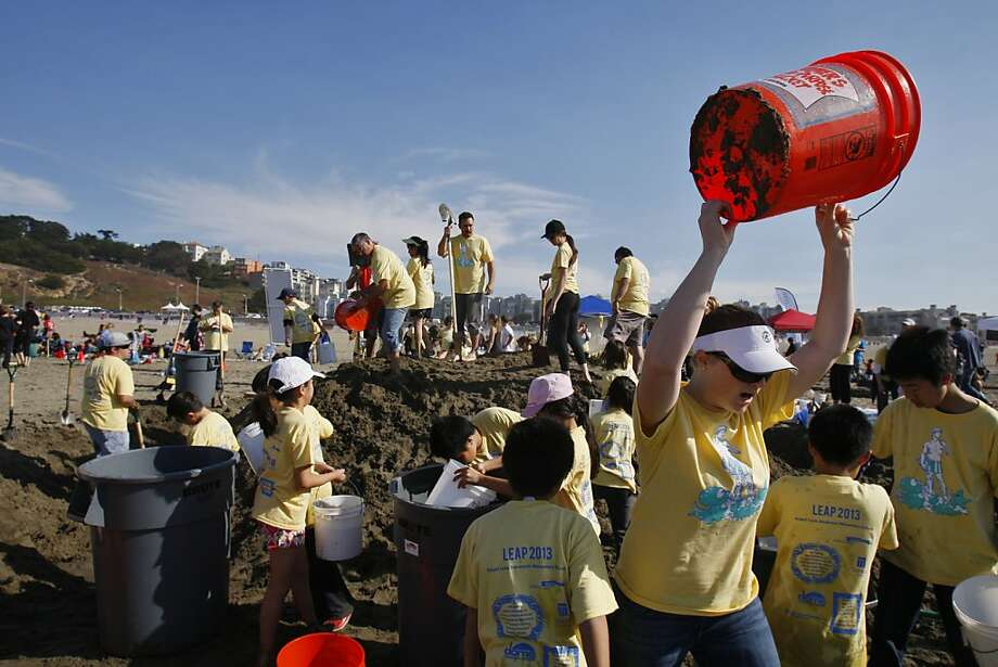 Brynda Kirk rallies her team from Robert Louis Stevenson Elementary to collect more water during the Leap Sand Castle Contest at Ocean Beach in San Francisco, Calif. on Saturday, Nov. 9, 2013. Photo: Raphael Kluzniok, The Chronicle