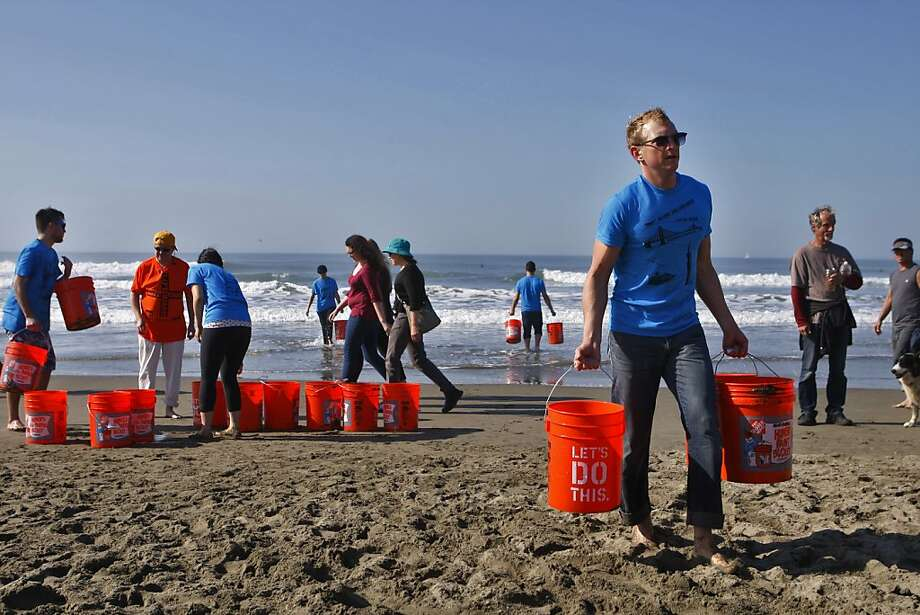 Daniel Epperson carries water  during the Leap Sand Castle Contest at Ocean Beach in San Francisco, Calif. on Saturday, Nov. 9, 2013. Photo: Raphael Kluzniok, The Chronicle