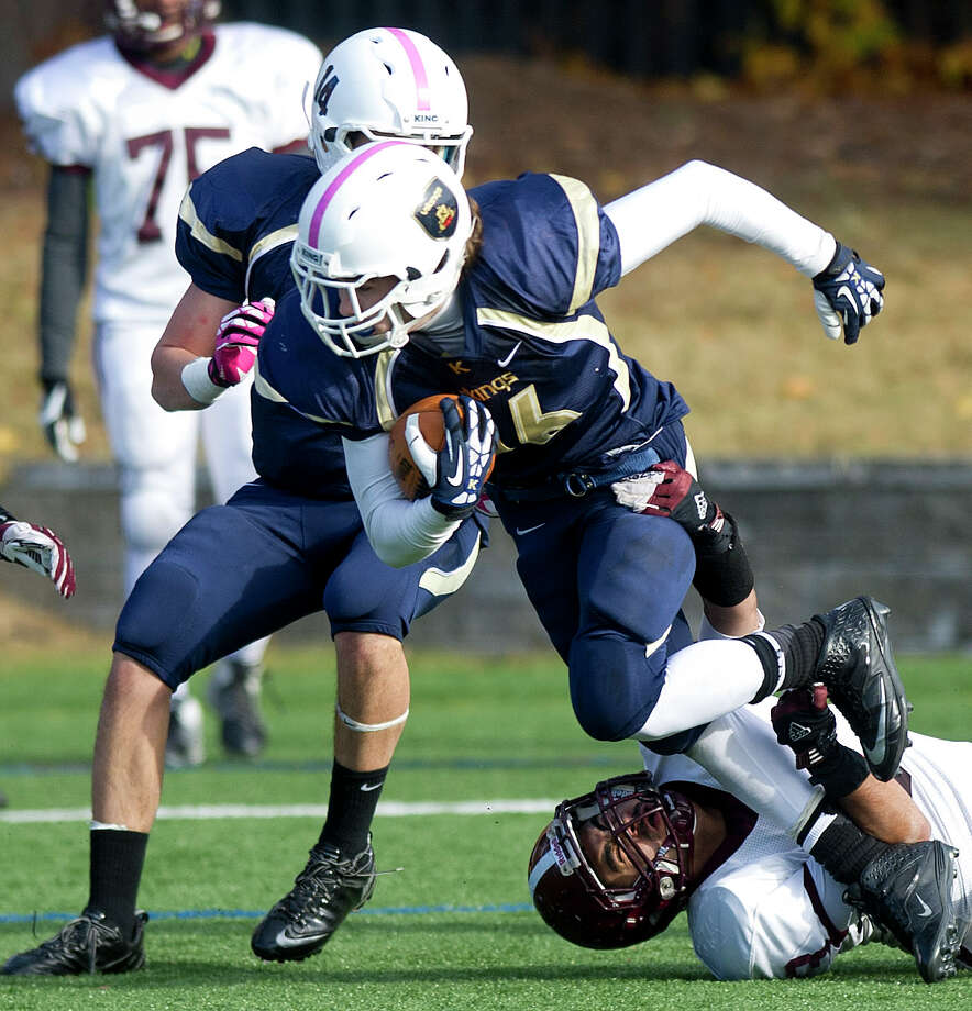 King's John McAllister carries the ball during Saturday's football game at King on November 9, 2013. Photo: Lindsay Perry / Stamford Advocate