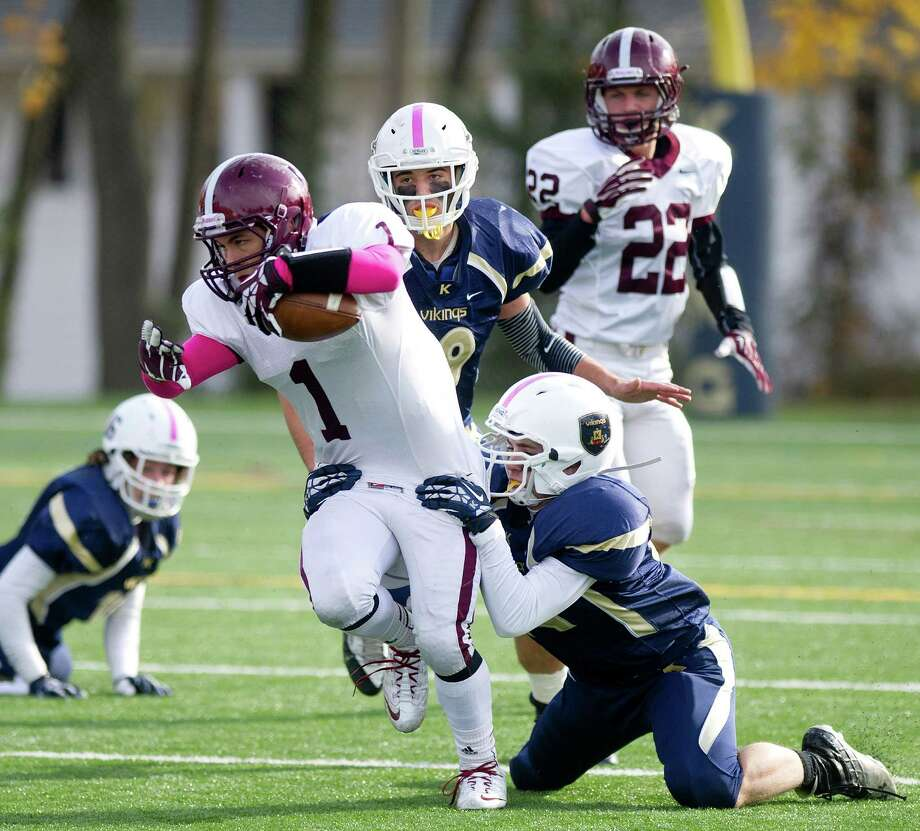 St. Luke's J.B. Boggs carries the ball during Saturday's football game at King on November 9, 2013. Photo: Lindsay Perry / Stamford Advocate