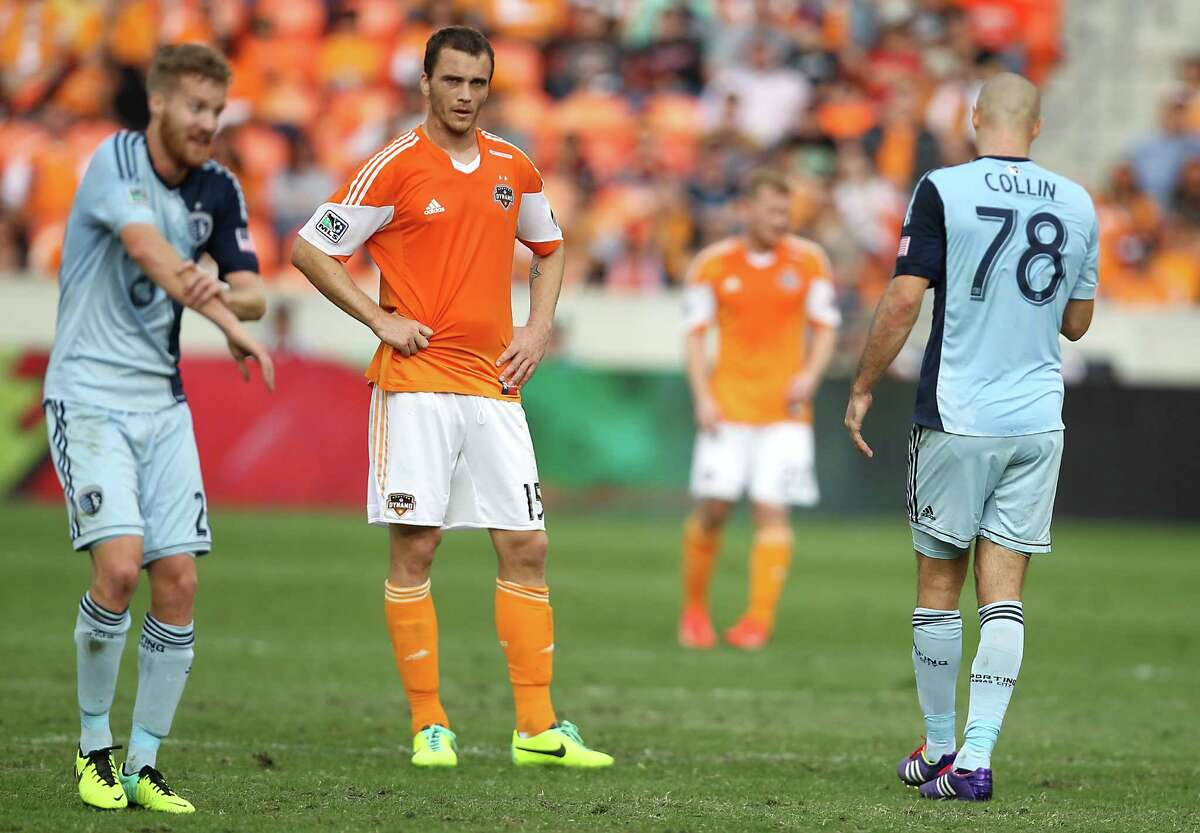 Sporting KC midfielder Oriol Rosell left, Houston Dynamo forward Cam Weaver center and Sporting KC defender Aurelien Collin right, during the second half of the MLS Eastern Conference Final game at BBVA Compass Stadium Saturday, Nov. 9, 2013, in Houston.