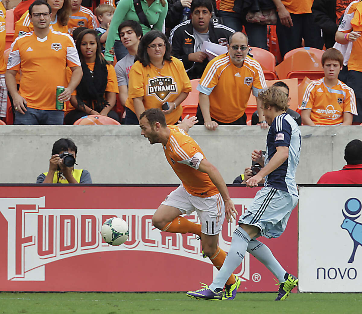 Houston Dynamo midfielder Brad Davis left, and Sporting KC defender/midfielder Chance Myers right, during the first half of the MLS Eastern Conference Final game at BBVA Compass Stadium Saturday, Nov. 9, 2013, in Houston.