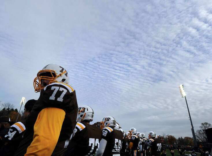 At left, Will Rusk (# 77) of Brunswick during the High School football game between Brunswick School