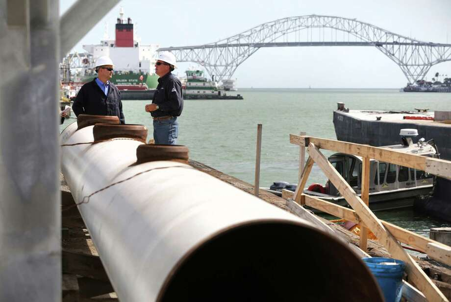Steven Schmidt, right, Terminal Manager of NuStar in Port Corpus Christi, talks with Greg Matula, also of NuStar, at the contraction site of the new pier for oil tankers.  Monday, Oct. 28, 2013. Photo: Bob Owen, San Antonio Express-News / ©2013 San Antonio Express-News