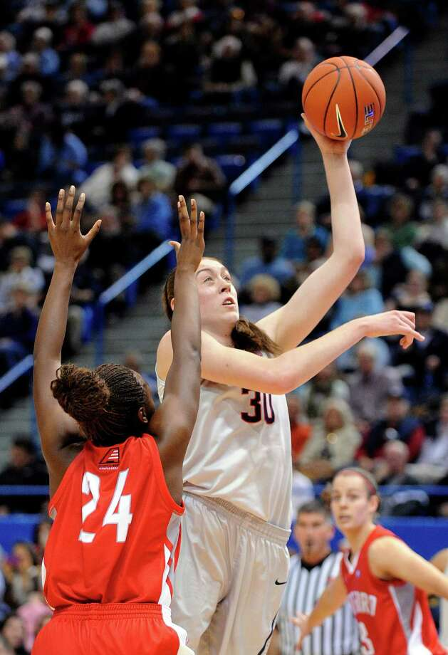 Connecticut forward Breanna Stewart (30) shoots over Hartford forward Alyssa Reaves (24) during the first half of an NCAA college basketball game in Hartford, Conn., on Saturday, Nov. 9, 2013. Photo: Fred Beckham, AP / Associated Press