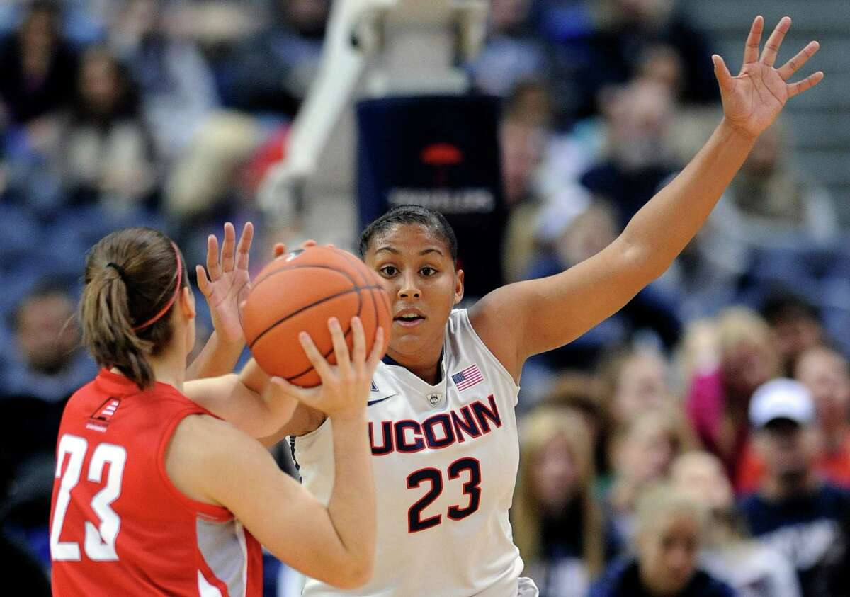 Connecticut forward Kaleena Mosqueda-Lewis, right, guards Hartford guard Alyssa Englert during the first half of an NCAA college basketball game in Hartford, Conn., on Saturday, Nov. 9, 2013.