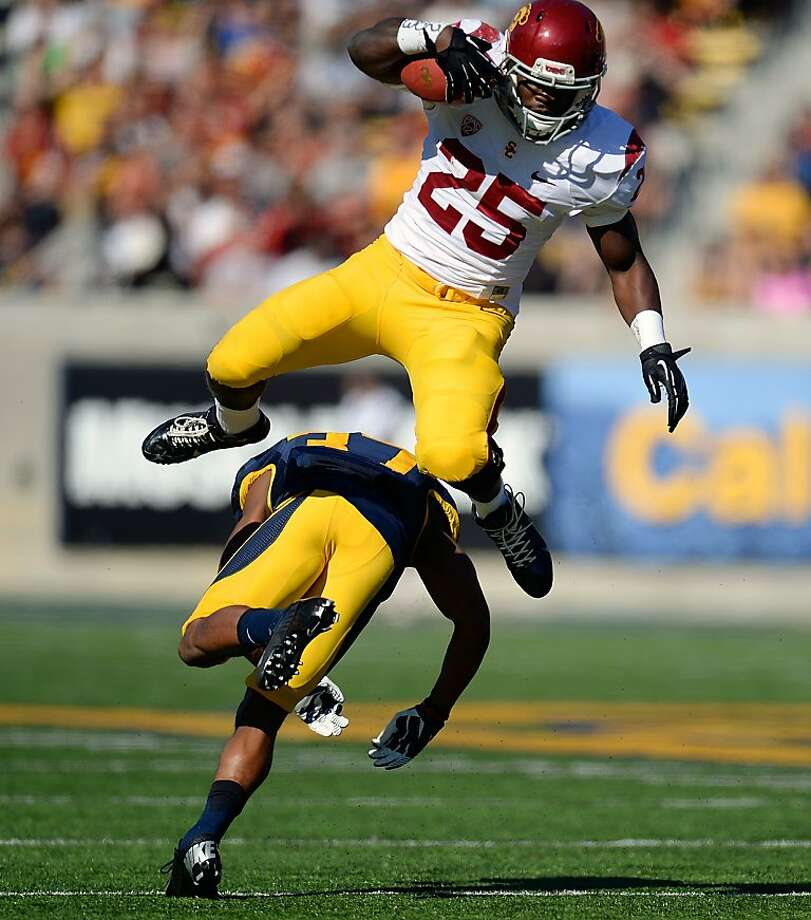 BERKELEY, CA - NOVEMBER 09:  Silas Redd #25 of the USC Trojans leaps over would be tackler Cedric Dozier #37 of the California Golden Bears during the first quarter at California Memorial Stadium on November 9, 2013 in Berkeley, California.  (Photo by Thearon W. Henderson/Getty Images)  *** BESTPIX *** Photo: Thearon W. Henderson, Getty Images