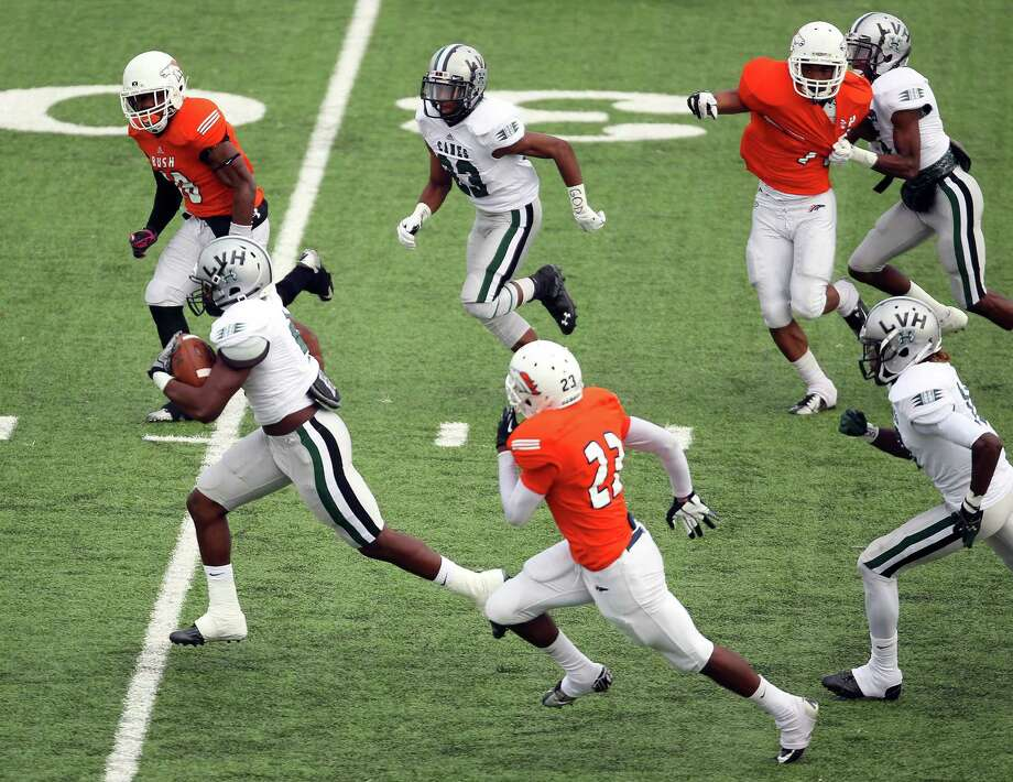 Hightower's Roosevelt Appleton, bottom left, rushes for a 45-yard touchdown during the first half of a high school football game against Bush, Saturday, November 9, 2013, at Mercer Stadium in Sugar Land. Photo: Eric Christian Smith, For The Chronicle