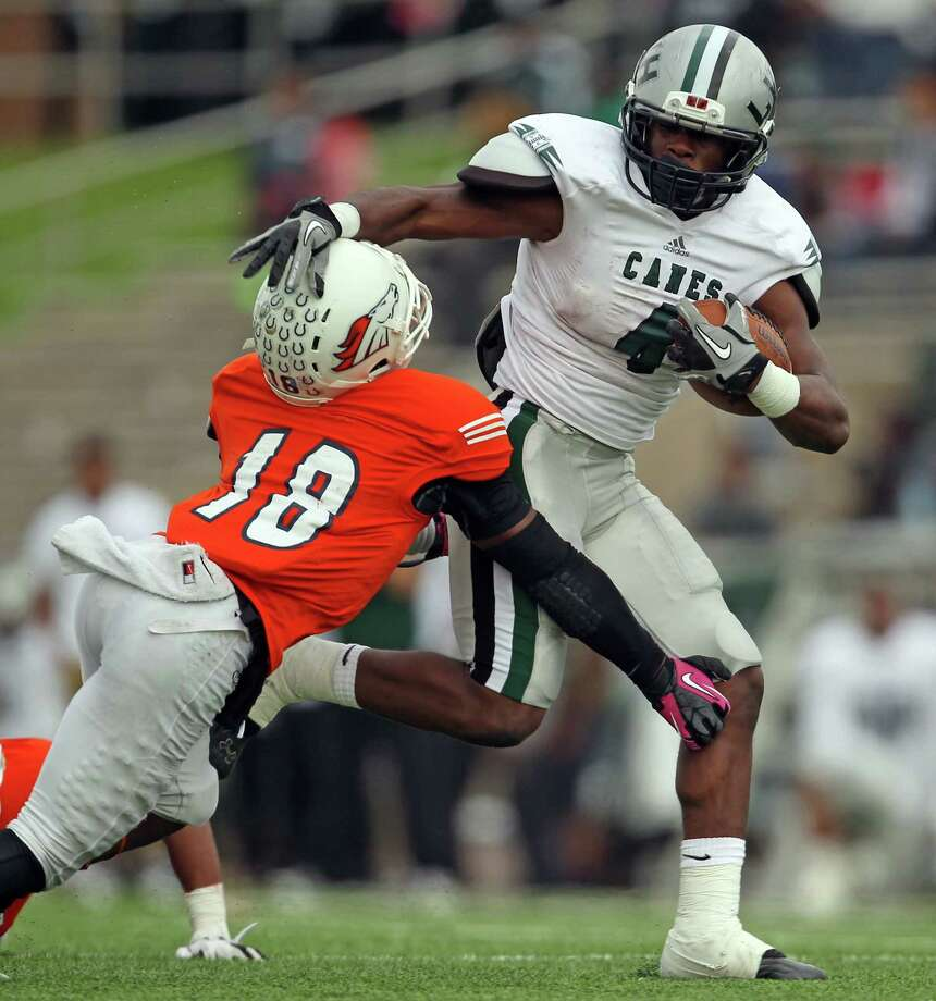 Hightower's Roosevelt Appleton, right, fends off Bush's Dareeus Townsend during the first half of a high school football game, Saturday, November 9, 2013, at Mercer Stadium in Sugar Land. Photo: Eric Christian Smith, For The Chronicle