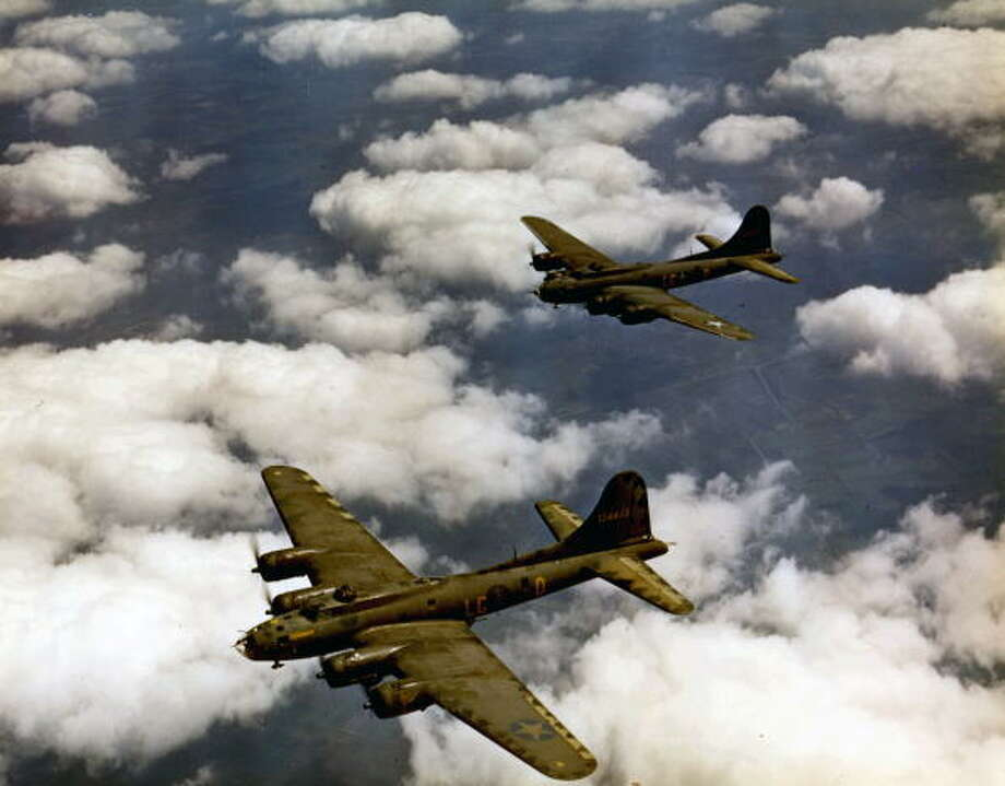 Aerial view of Boeing B-17 Flying Fortress heavy bombers (from the 322 Bomb Squadron, 91st Bomb Group, 8th Air Force) en route on a mission to Germany, early to mid 1940s. Photo: PhotoQuest, Getty Images / Archive Photos
