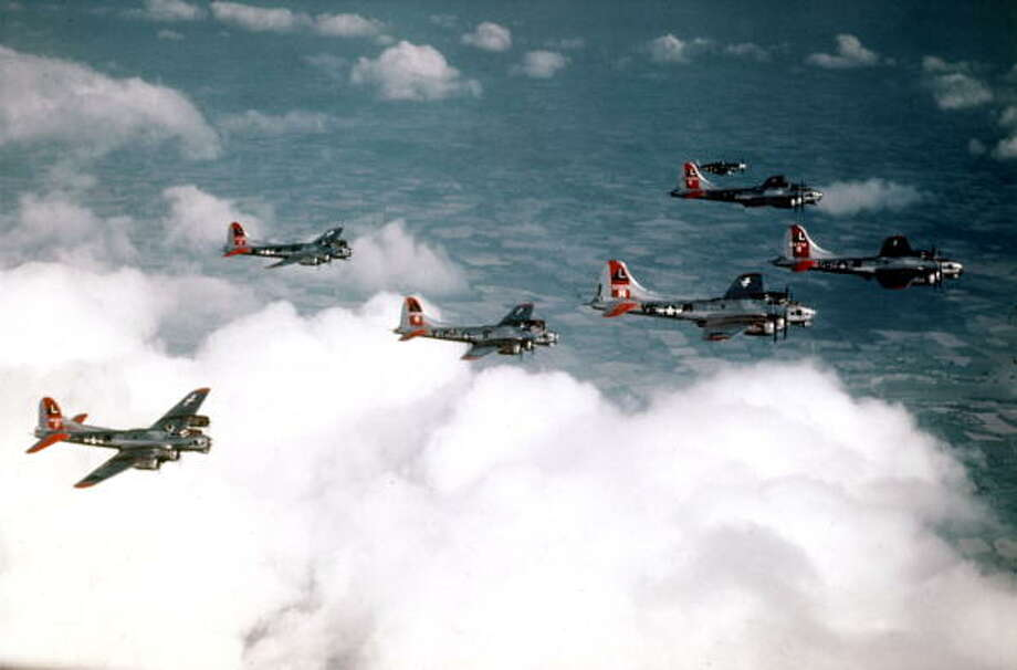 World War II, March 1945, B-17's of the 381st B Group fly in formation with an Escort P-51 Mustang in the background Photo: Popperfoto, Getty Images / Popperfoto