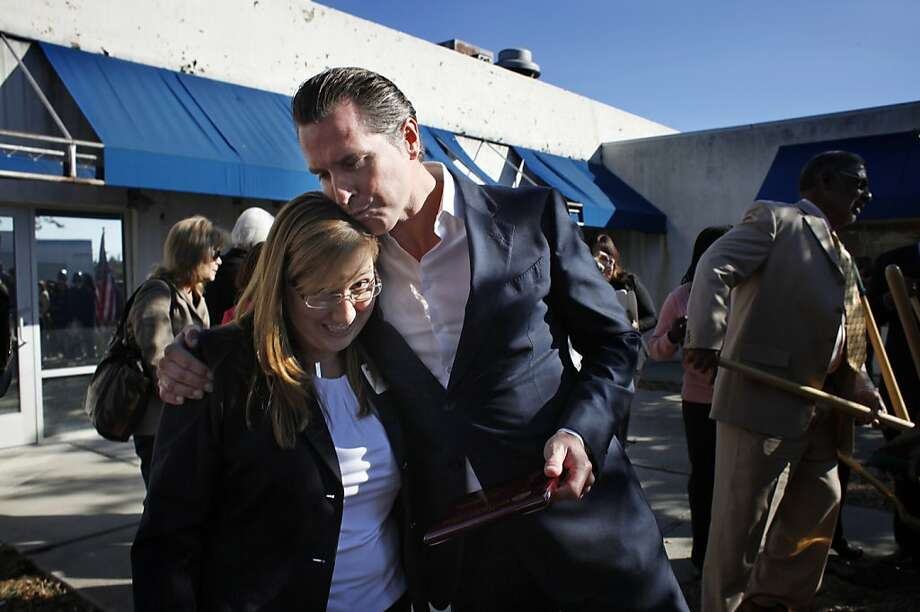 Melissa Caine-Huckabay, project director of the West Contra Costa County Family Justice Center, and Lt. Gov. Gavin Newsom attend a groundbreaking ceremony. The nonprofit 4Richmond helped pull together community partners to support the project. Photo: Lacy Atkins, The Chronicle