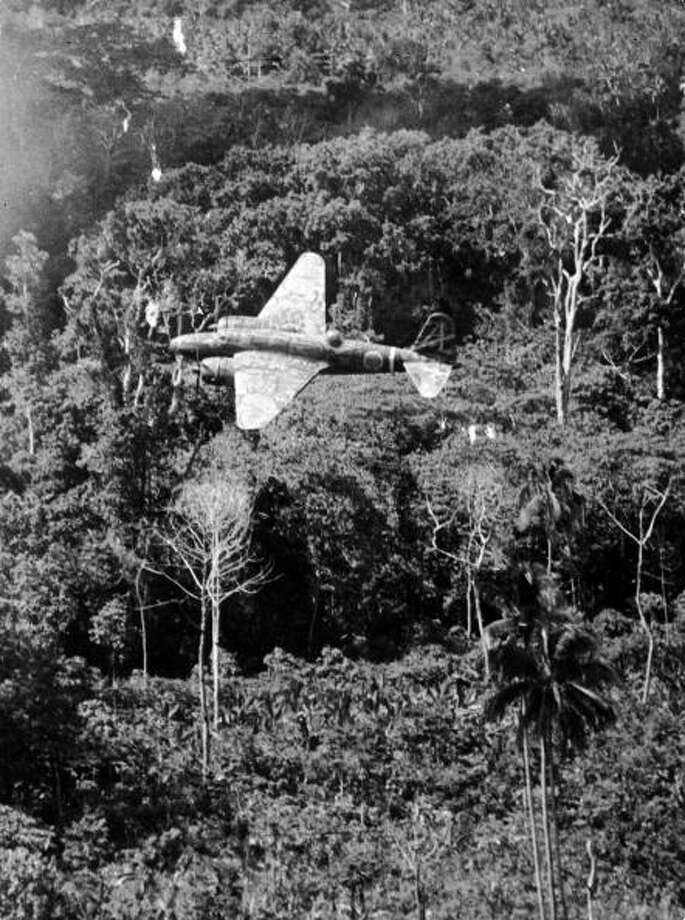"Japanese Mitsubishi ""Sally"" Mark III in flight somewhere over a jungle in the Pacific during WWII. Photo: US Air Force, Getty Images / Time & Life Pictures"