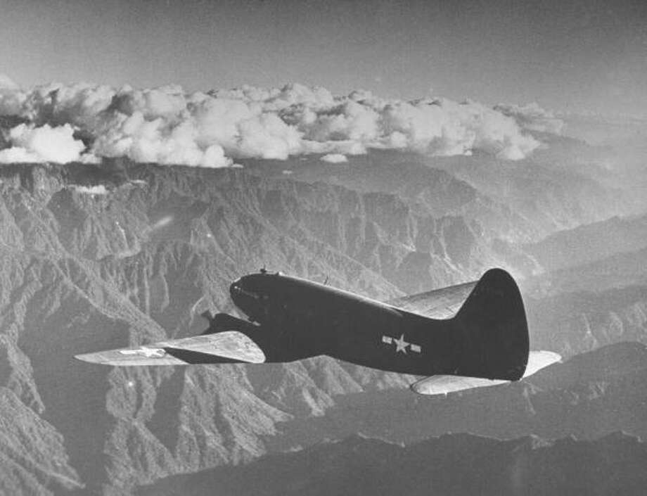 "American C-46 transport flying ""the Hump"" a long, difficult flight over the Himalayas, to supply Chinese and other Allied troops in their fight against Japanese invasion of China Photo: William Vandivert., Getty Images / Time & Life Pictures"