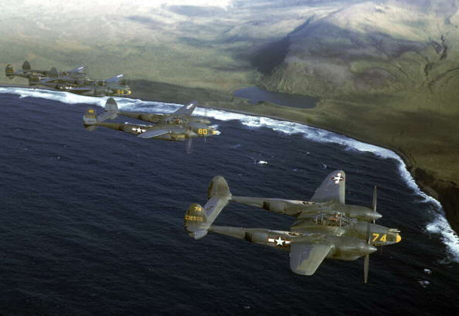 A squadron of American Lockheed P-38 Lightning fighter planes in flight over an unidentified Aleutian Island, Alaska, 1944. Photo: Dmitri Kessel, Getty Images / Time Life Pictures