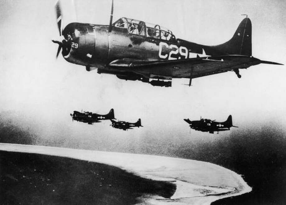 A group of US Navy Douglas Dauntless dive-bombers prepare for a run on Japanese-held Eniwetok in the Marshall Islands, 1944. Photo: Keystone, Getty Images / 2004 Getty Images