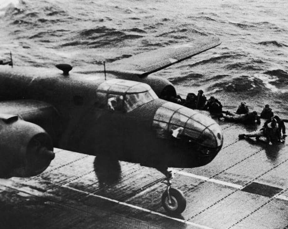 Pilot Jimmy Doolittle starting his takeoff run aboard the aircraft carrier Hornet as he begins America's first bombing raid on the Japanese mainland, the city of Tokyo. Photo: Time Life Pictures, Getty Images / Time Life Pictures