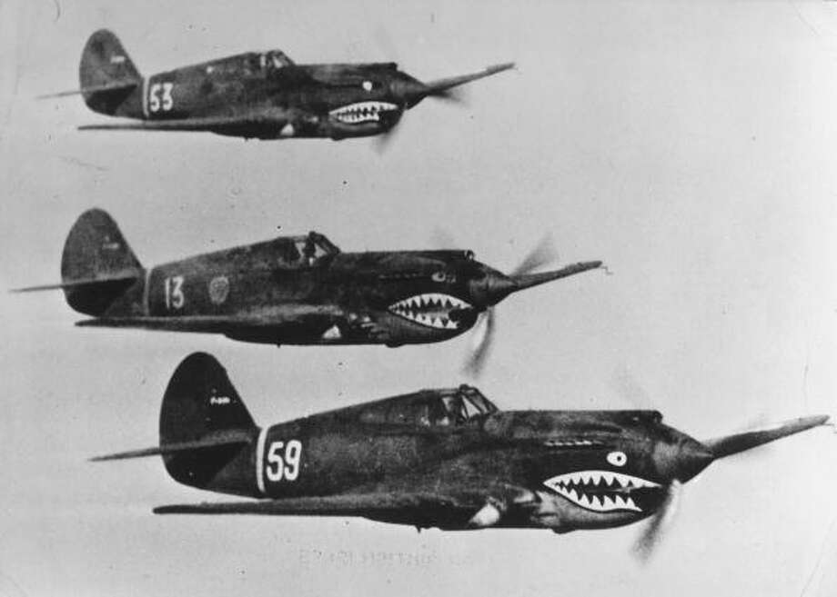 "American Volunteer Group aircraft, known by the Chinese as the ""flying tigers,"" flying in tight formation on the Far Eastern front where they are aiding the Chinese Army against the Japanese. Photo: Three Lions, Getty Images / Hulton Archive"